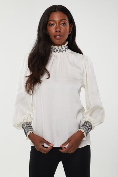 Fluid blouse with ruching