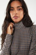 Geometric print turtleneck top