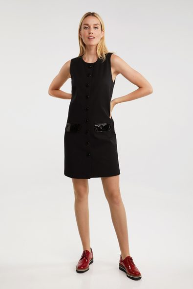 Sleeveless dress with flap pockets